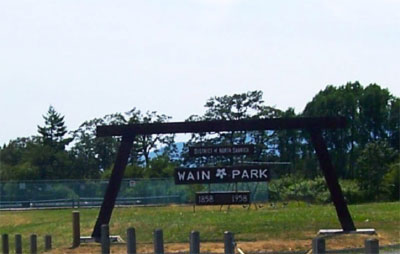 This image has an empty alt attribute; its file name is Wain-Park-sign.jpg